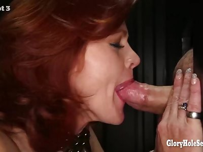 Gloryhole Secrets mature redhead drinks cum
