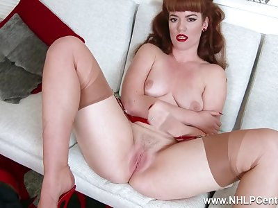Redhead Zoe Page taunts her pert tits and wet pussy in retro red undergarments